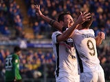 Franco Vazquez of Palermo celebrates with Paulo Dybala after scoring his team's third goal during the Serie A match betweeen Atalanta BC and US Citta di Palermo at Stadio Atleti Azzurri d'Italia on December 21, 2014