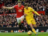 Manchester United's English defender Phil Jones vies with Liverpool's English midfielder Adam Lallana during the English Premier League football match between Manchester United and Liverpool at Old Trafford in Manchester, north west England, on December 1