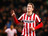 Luuk de Jong of PSV Eindhoven celebrates scoring his teams first goal of the game during the Eredivisie match between PSV Eindhoven and Feyenoord Rotterdam held at the Philips Stadion on December 17, 2014