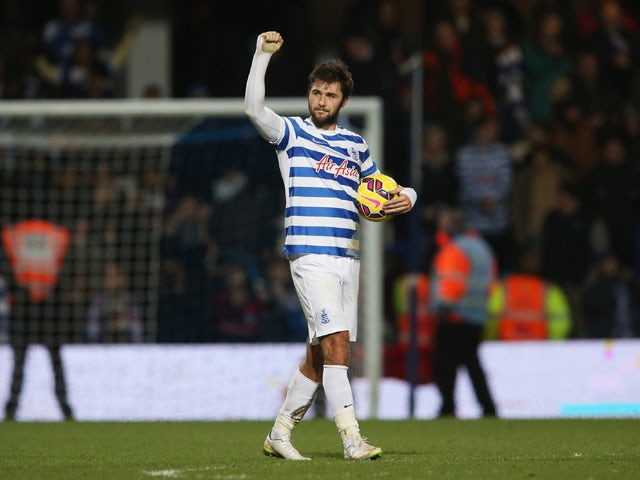 Charlie Austin of QPR celebrates victory after his three goals during the Barclays Premier League match between Queens Park Rangers and West Bromwich Albion at Loftus Road on December 20, 2014