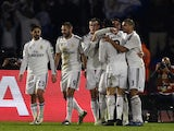 Real Madrid's players congratulate their teammate Sergio Ramos after he scored a goal against San Lorenzo during their FIFA Club World Cup final football match at the Marrakesh stadium in the Moroccan city of Marrakesh on December 20, 2014