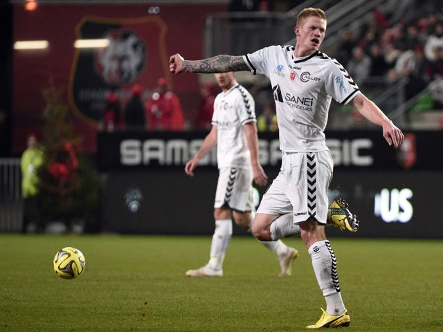 Reims' French forward Gaetan Charbonnier jubilates after he scored a goal during the French L1 football match Rennes (SRFC) vs Reims (SR) on December 20, 2014