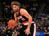 Robin Lopez #42 of the Portland Trail Blazers controls the ball against the Denver Nuggets at Pepsi Center on November 12, 2014