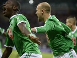 Saint-Etienne's Ivorian forward Max-Alain Gradel celebrates with his teammates after opening the scoring during the French L1 football match AS Saint-Etienne (ASSE) vs Evian (ETGFC) on December 21, 2014