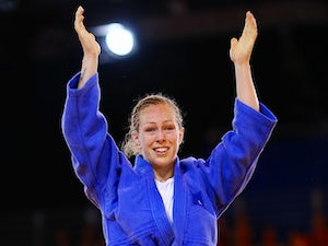 Sally Conway of Scotland celebrates winning the Women's -70kg Bronze Medal Contest against Sunibala Huidrom on July 25, 2014