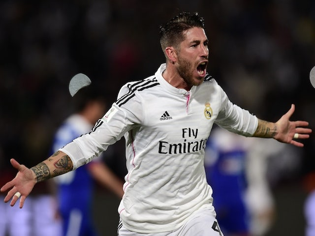 84260dc836 Real Madrid's defender Sergio Ramos celebrates after scoring a goal during  the FIFA World Club Cup