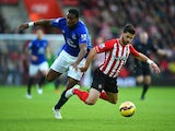 Sylvain Distin of Everton and Shane Long of Southampton battle for the ball during the Barclays Premier League match between Southampton and Everton at St Mary's Stadium on December 20, 2014