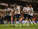 Nabil Bentaleb of Tottenham Hotspur celebrates scoring the opening goal with team mates during the Capital One Cup Quarter-Final match between Tottenham Hotspur and Newcastle United at White Hart Lane on December 17, 2014