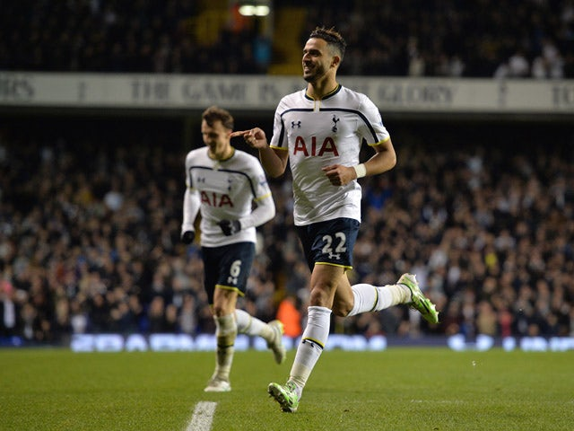 Tottenham Hotspur's Belgian midfielder Nacer Chadli celebrates scoring their second goal during the English League Cup quarter-final football match between Tottenham Hotspur and Newcastle United at White Hart Lane in London on December 17, 2014