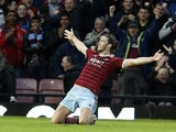 West Ham United's English striker Andy Carroll celebrates scoring the opening goal of the English Premier League football match between West Ham United and Leicester City at the Boleyn Ground, Upton Park, in east London, on December 20, 2014