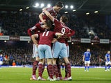 West Ham United's English midfielder Stewart Downing celebrates with teammates after scoring their second goal during the English Premier League football match between West Ham United and Leicester City at the Boleyn Ground, Upton Park, in east London, on
