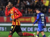 Lens' French midfielder Wylan Cyprien (L) jubilates after scoring a goal during the French L1 football match Lens (RCL) vs Nice (OGCN) on December 19, 2014