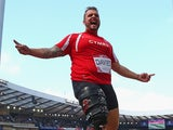 Aled Davies of Wales celebrates as he competes in the Men's F42/44 Discus final at Hampden Park Stadium on July 28, 2014
