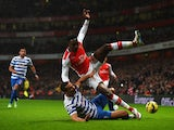 Rio Ferdinand of QPR tackles Danny Welbeck of Arsenal during the Barclays Premier League match between Arsenal and Queens Park Rangers at Emirates Stadium on December 26, 2014