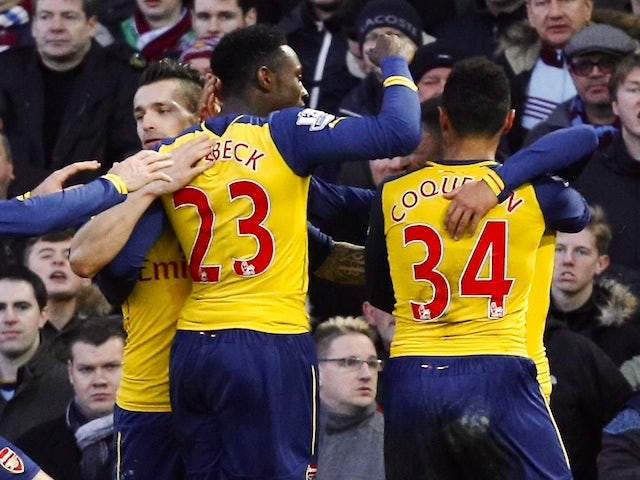 Arsenal celebrates after Arsenal's English striker Danny Welbeck scored their second goal during the English Premier League football match against West Ham on December 28, 2014