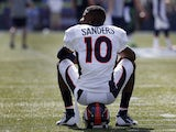 Wide receiver Emmanuel Sanders #10 of the Denver Broncos sits on his helmet before the game against the Seattle Seahawks at CenturyLink Field on September 21, 2014