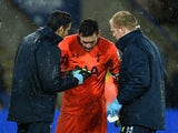 Hugo Lloris of Spurs receives treatment for an injury during the Barclays Premier League match against Leicester City on December 27, 2014