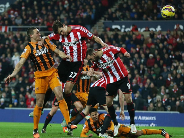 Hull City's English defender James Chester scores their second goal during the English Premier League football match between Sunderland and Hull City at The Stadium of Light in Sunderland, north east England on December 26, 2014