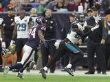 Allen Hurns #88 of the Jacksonville Jaguars catches the ball in the first quarter while under pressure by Johnathan Joseph #24 of the Houston Texans in a NFL game on December 28, 2014
