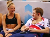 Laura Trott (L) alongside her boyfriend and team mate Jason Kenny (R) during practise ahead of the UCI Track World Championships at Minsk Arena on February 19, 2013