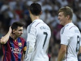 Barcelona's Lionel Messi stands next to Real Madrid duo Cristiano Ronaldo and Toni Kroos during the 'El Clasico' La Liga match on October 25, 2014