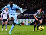 Yaya Toure of Manchester City scores his team's second goal from the penalty spot during the Barclays Premier League match between West Bromwich Albion and Manchester City at The Hawthorns on December 26, 2014