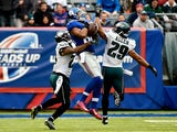 Rueben Randle #82 of the New York Giants makes a catch in the first quarter as Nolan Carroll #23 and Nate Allen #29 of the Philadelphia Eagles defend during a game at MetLife Stadium on December 28, 2014