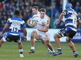 Sam Hill (C) of Exeter runs at Leroy Houston (R) and Kyle Eastmond (L) of Bath during the Aviva Premiership match on December 27, 2014