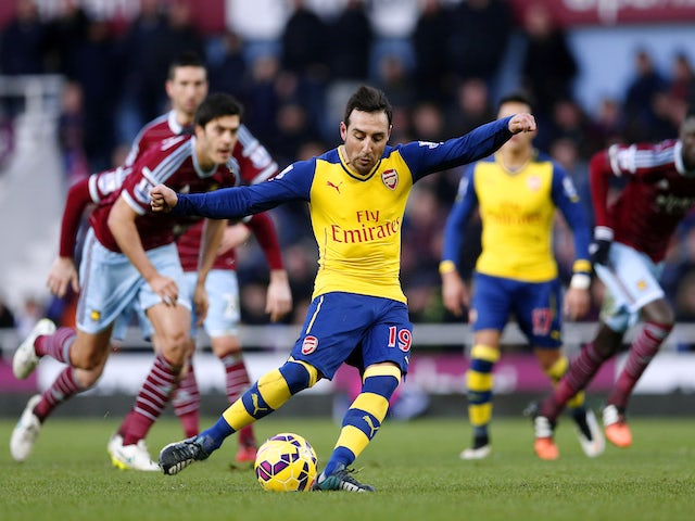 Santi Cazorla of Arsenal scores the opening goal from the penalty spot during the Barclays Premier League match against West Ham United on December 28, 2014