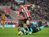 Adam Johnson of Sunderland rounds goalkeeper Allan McGregor of Hull City to score the opening goal following a poor back pass during the Barclays Premier League match between Sunderland and Hull City at the Stadium of Light on December 26, 2014