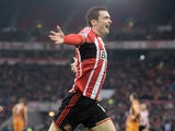 Adam Johnson of Sunderland celebrates after scoring the opening goal during the Barclays Premier League match between Sunderland and Hull City at the Stadium of Light on December 26, 2014