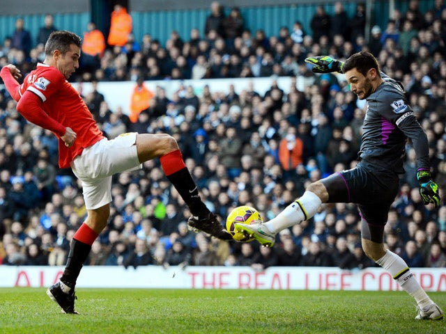 Robin van Persie of Manchester United has his attempt on goal saved by goalkeeper Hugo Lloris of Spurs during the Barclays Premier League match between Tottenham Hotspur and Manchester United at White Hart Lane on December 28, 2014