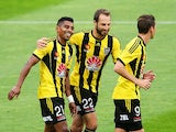 Roy Krishna of the Phoenix is congratulated on his goal by teammates Andrew Durante and Nathan Burns during the round 13 A-League match between the Wellington Phoenix and the Western Sydney Wanderers at Westpac Stadium on December 28, 2014