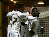 Wolves celebrate with Nouha Dicko after he scores to make it 1-0 during the Sky Bet Championship match between Watford and Wolverhampton Wanderers at Vicarage Road on December 26, 2014