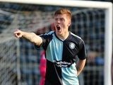 Alfie Mawson of Wycombe Wanderers in action during the Sky Bet League Two match between Wycombe Wanderers and Northampton Town at Adams Park on October 4, 2014