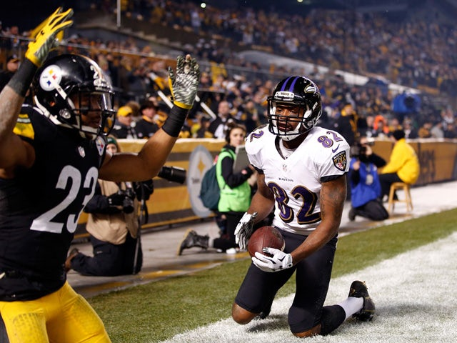 Torrey Smith #82 of the Baltimore Ravens celebrates a third quarter touchdown against the Pittsburgh Steelers during their AFC Wild Card game at Heinz Field on January 3, 2015