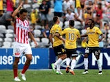 Mariners players Mitchell Duke, Isaka Cernak, Glen Trifiro and Anthony Caceres celebrate a goal with Melbourne City looking dejected in frame during the round 15 A-League match between the Central Coast Mariners and Melbourne City FC at Central Coast Stad