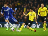 Fernando Forestieri of Watford is challenged by Ramires of Chelsea during the FA Cup Third Round match between Chelsea and Watford at Stamford Bridge on January 4, 2015