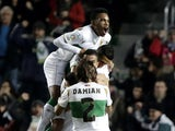 Elche platers celebrate their second goal during the Spanish league football match Elche FC v Villarreal CF at the Martinez Valero stadium in Elche on January 3, 2015