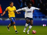 Emile Heskey (R) of Bolton in action with James Tavernier of Wigan during the FA Cup Third Round match on January 3, 2015