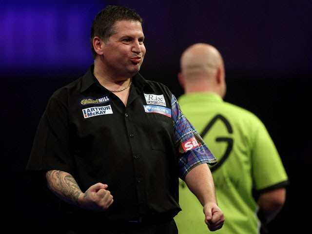 Gary Anderson of Scotland celebrates winning a set during his semi final match against Michael van Gerwen of the Netherlands on day thirteen of the 2015 William Hill PDC World Darts Championships at Alexandra Palace on January 3, 201