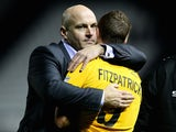 Gary Brabin, manager of Southport consoles David Fitzpatrick of Southport during the FA Cup Third Round match against Derby County on January 3, 2015