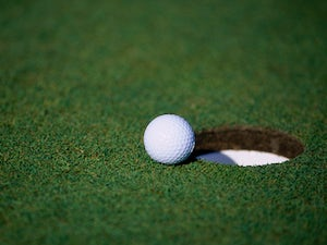A general view of a golf ball sitting near a hole for the Michelob Championships at the Kingsmill Golf Course in Williamsburg