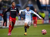Nahki Wells of Huddersfield gets past Jordan Obita of Reading during the FA Cup Third Round match between Huddersfield Town and Reading at Galpharm Stadium on January 3, 2015