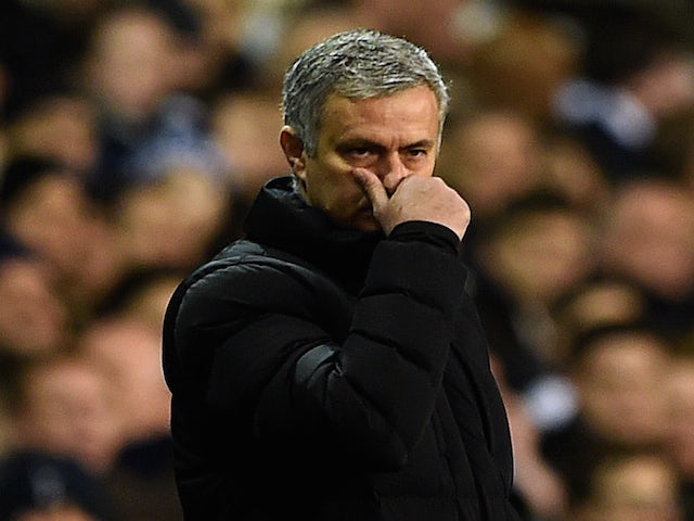 Jose Mourinho, manager of Chelsea reacts on the touchline next to Mauricio Pochettino, manager of Spurs during the Barclays Premier League on January 1, 2015