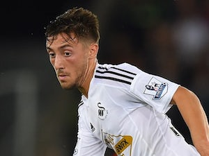 Josh Sheehan in action for Swansea on August 26, 2014