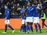 Leonardo Ulloa of Leicester City celebrates scoring the opening goal with team mates during the FA Cup Third Round match between Leicester City and Newcastle United at The King Power Stadium on January 3, 2015