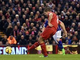 Liverpool's English midfielder Steven Gerrard scores his team's first goal from a penalty during the English Premier League football match between Liverpool and Leicester City at Anfield in Liverpool, north west England, on January 1, 2015