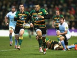 Luther Burrell of Northampton breaks with the ball during the Aviva Premiership match against Newcastle Falcons on January 2, 2015