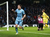 James Milner of Manchester City celebrates after scoring a goal to level the scores at 1-1 during the FA Cup Third Round match between Manchester City and Sheffield Wednesday at Etihad Stadium on January 4, 2015